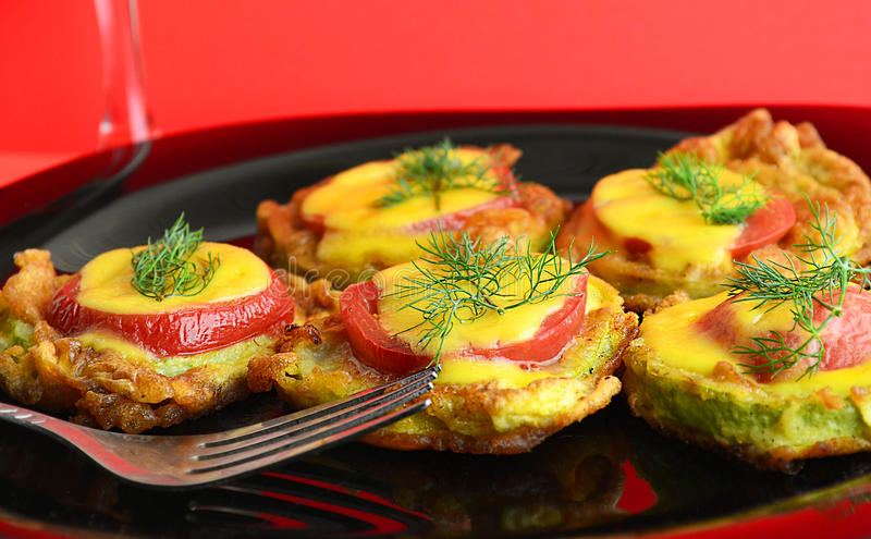 Appetizer of zucchini tomato and cheese. Appetizer of roasted zucchini tomato and cheese stock images