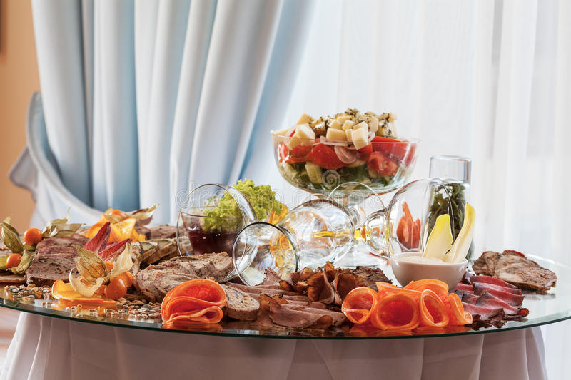 Appetizers at banquet table stock images