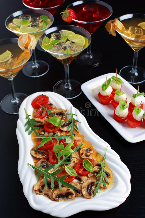 Appetizers with drinks for guests stock photos