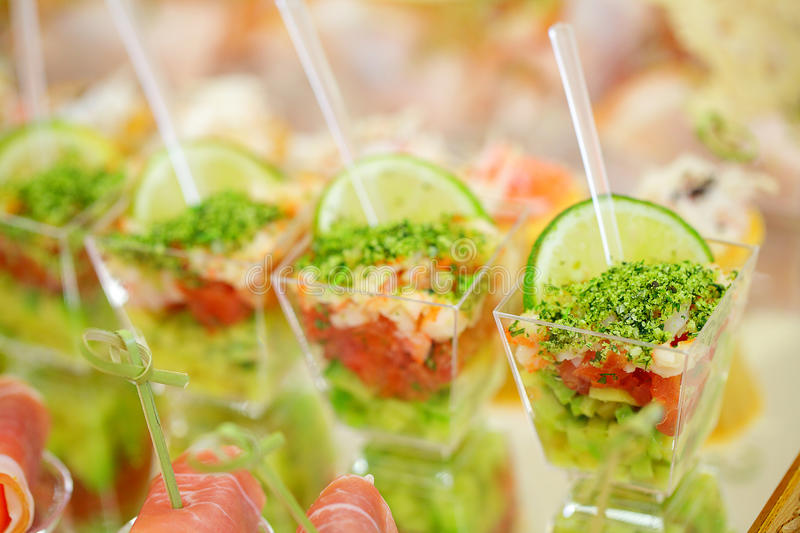 Appetizers, gourmet food. Vegetable salad and prosciutto, catering service royalty free stock photos