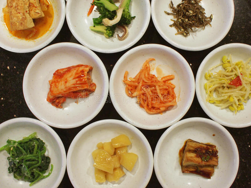 Appetizers in a Korean Meal. Many dishes of appetizers in a Korean Meal royalty free stock photos