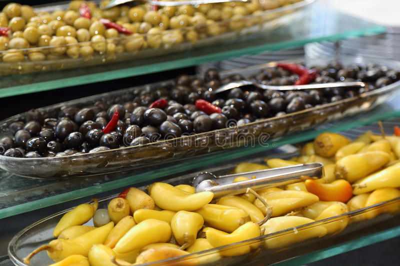 Appetizers - olives and green hot pepper. Appetizers - marinated olives and green hot pepper stock photo