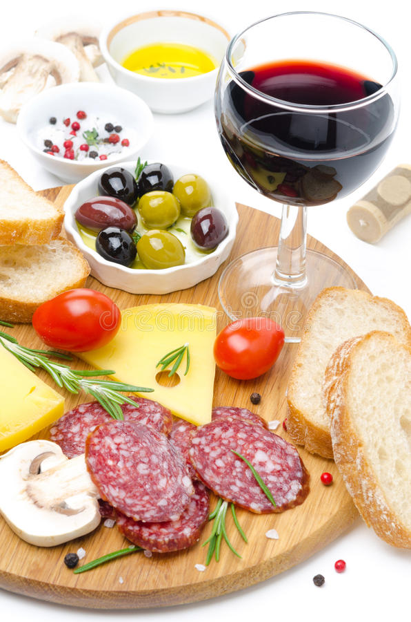 Appetizers - salami, cheese, bread, olives, tomatoes and wine. Appetizers - salami, cheese, bread, olives, tomatoes and glass of wine on white background royalty free stock images