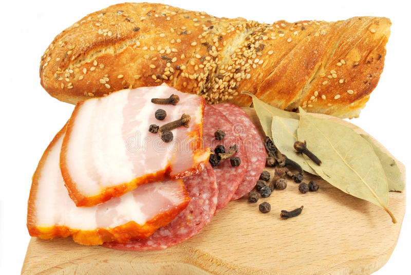 Appetizers of smoked meat and bread royalty free stock images