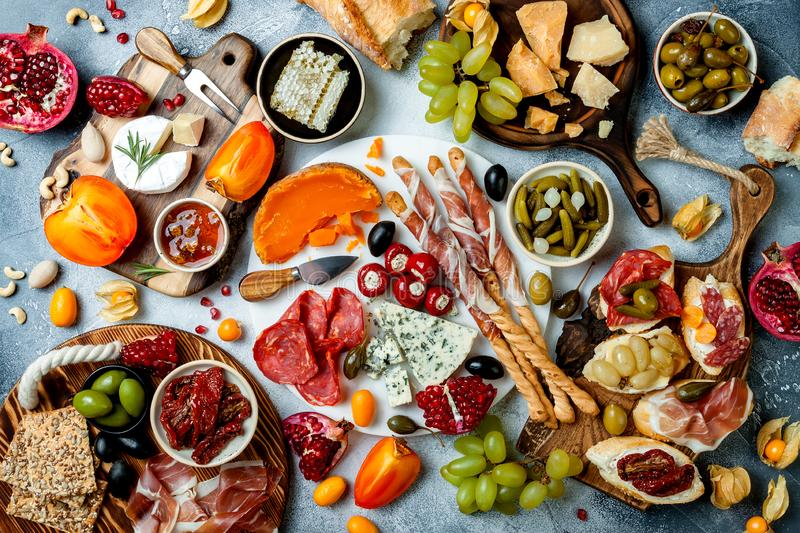 Appetizers table with antipasti snacks. Bruschetta or authentic traditional spanish tapas set, cheese and meat platter stock photography