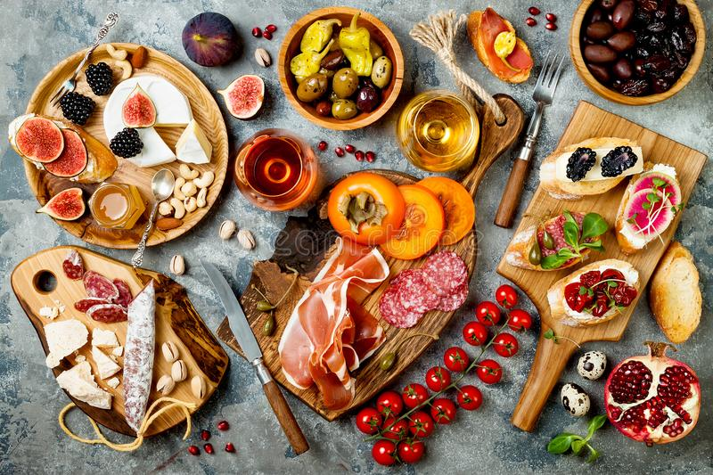 Download Appetizers Table With Italian Antipasti Snacks And Wine In Glasses. Brushetta Or Authentic Traditional & Appetizers Table With Italian Antipasti Snacks And Wine In Glasses ...
