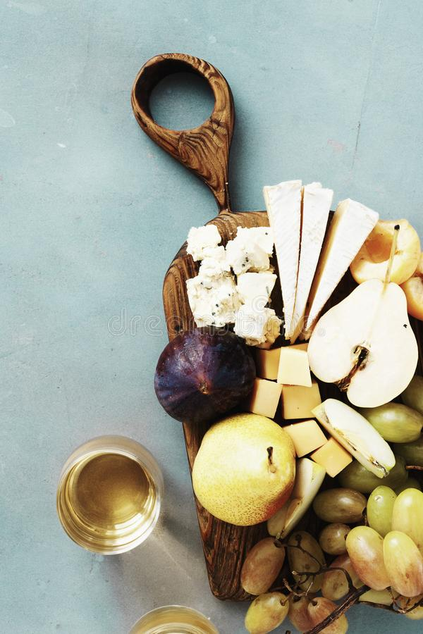 Appetizers table wine Fruit cheese wooden board background Wine appetizers. Appetizers table and wine. Fruit and cheese on wooden board on stone background. Wine royalty free stock photos