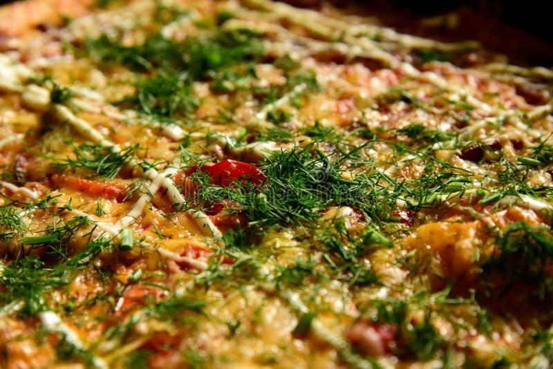Pizza background - macro shot delicious italian pizza royalty free stock photos