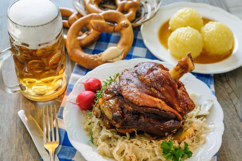 Appetizing Bavarian roast pork knuckle stock photography