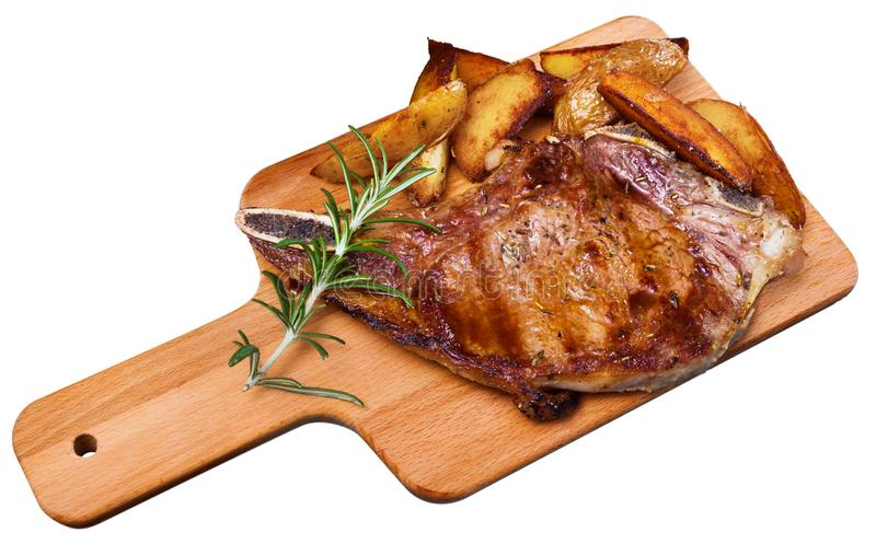 Appetizing beef steak with potatoes and rosemary. Isolated over white background royalty free stock photography