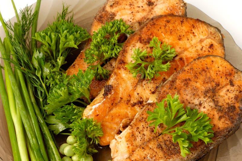 Appetizing fried salmon stock photography