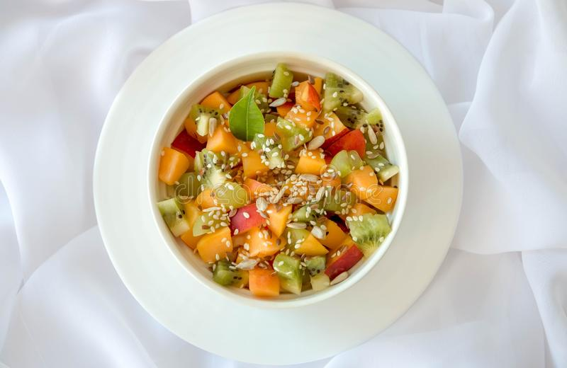 Appetizing fruit salad, on a white background stock images