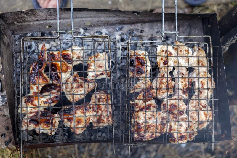 Appetizing grilled chicken on the grill royalty free stock image