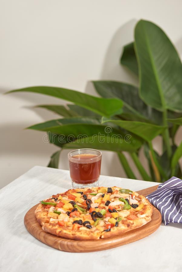 Appetizing homemade pizza on a white background royalty free stock photography