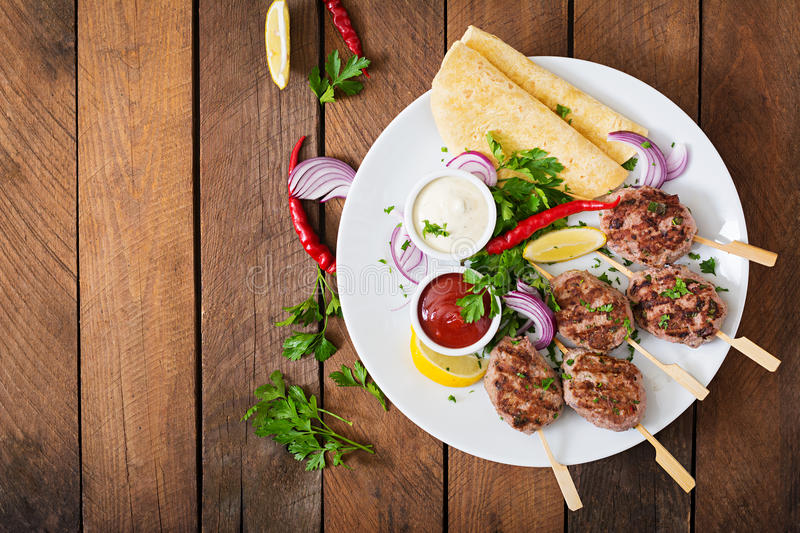 Appetizing kofta kebab (meatballs) with sauce royalty free stock image