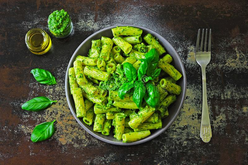 Appetizing pasta with pesto and basil. stock photo