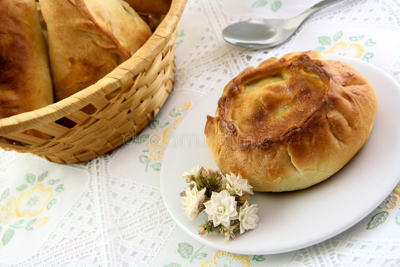 Appetizing Pie And Basket Of Pie In The Tablecloth Stock Photo