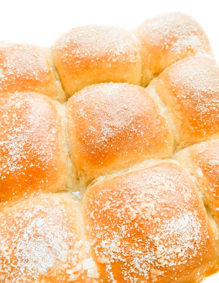Appetizing ruddy buns with sesame seeds on a baking sheet, homemade pastries. Freshly baked wheat buns with sesame seeds stock image