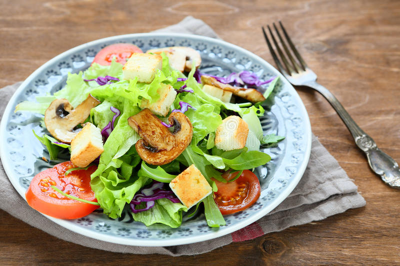 Appetizing salad with greens and mushrooms stock image