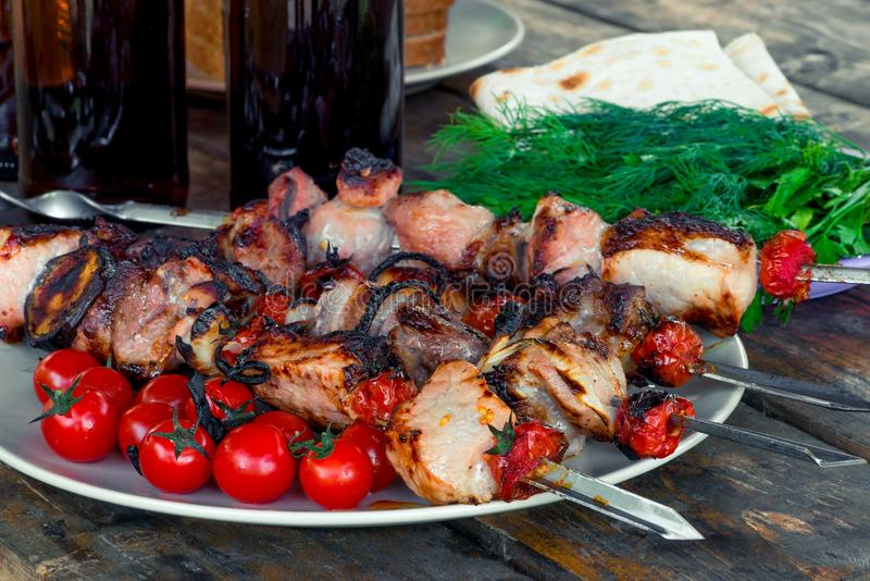 Appetizing tasty shish kebab with vegetables on skewers royalty free stock photos