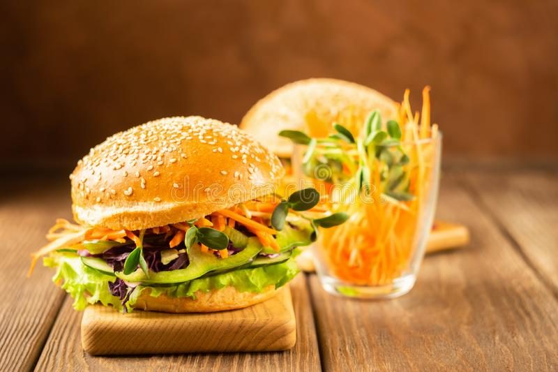 Appetizing veggie sandwich with fresh vegetables on a dark brown background. The concept of proper nutrition. stock image