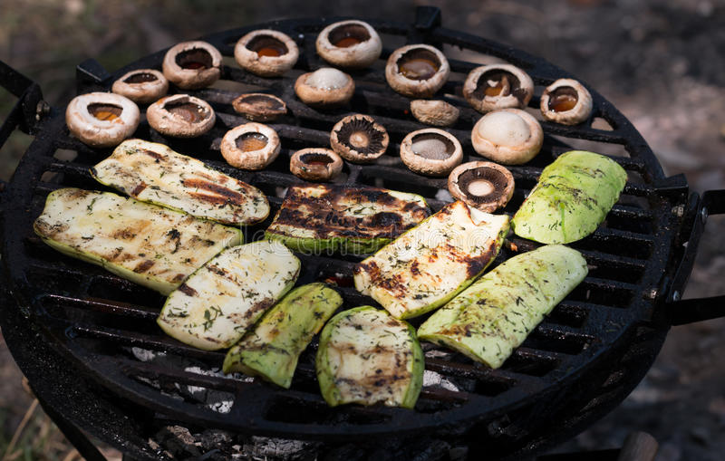 Appetizing zucchini and mushroom bake barbecue. Zucchini and mushroom bake barbecue stock photo