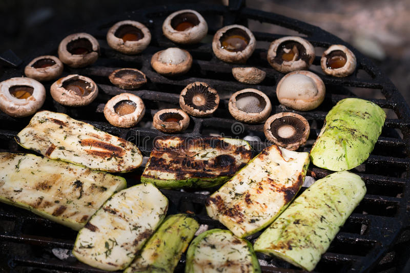Appetizing zucchini and mushroom bake barbecue. Zucchini and mushroom bake barbecue royalty free stock photos
