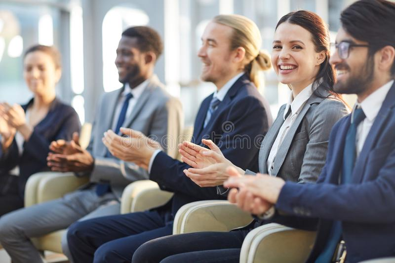 Applauding at business seminar royalty free stock photos