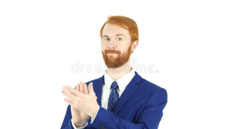 Applaudissant, homme d'affaires rouge de applaudissement de barbe de cheveux, fond blanc photographie stock libre de droits