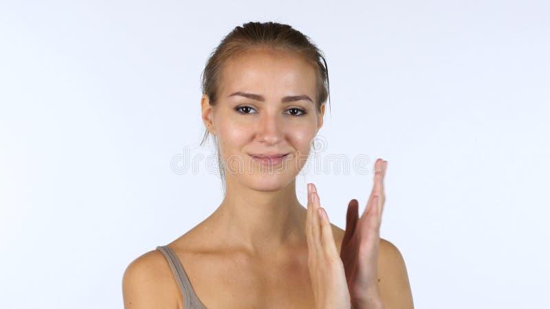 Applaudissement, applaudissements par la belle fille, fond blanc photographie stock