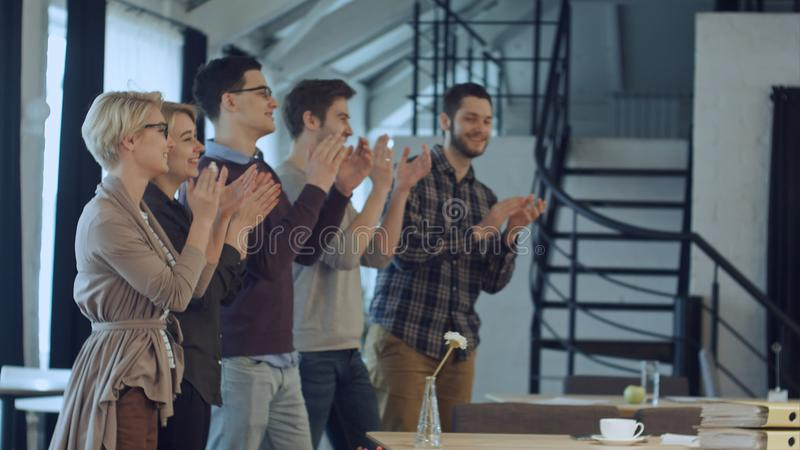 Applause of business startup people in the office as team stock images