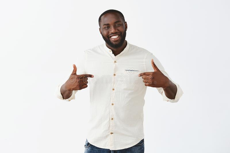 Applause me it was mine effort. Proud happy and pleased good-looking African American guy with beard and short haircut stock photo