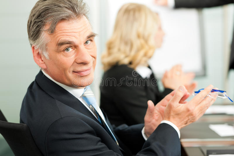 Applause for a presentation in business meeting royalty free stock images