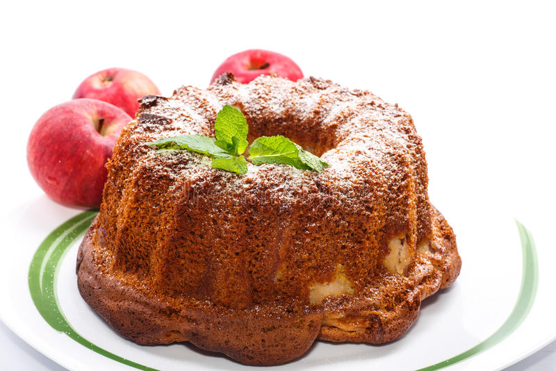 Apple και κέικ μελιού στοκ φωτογραφίες