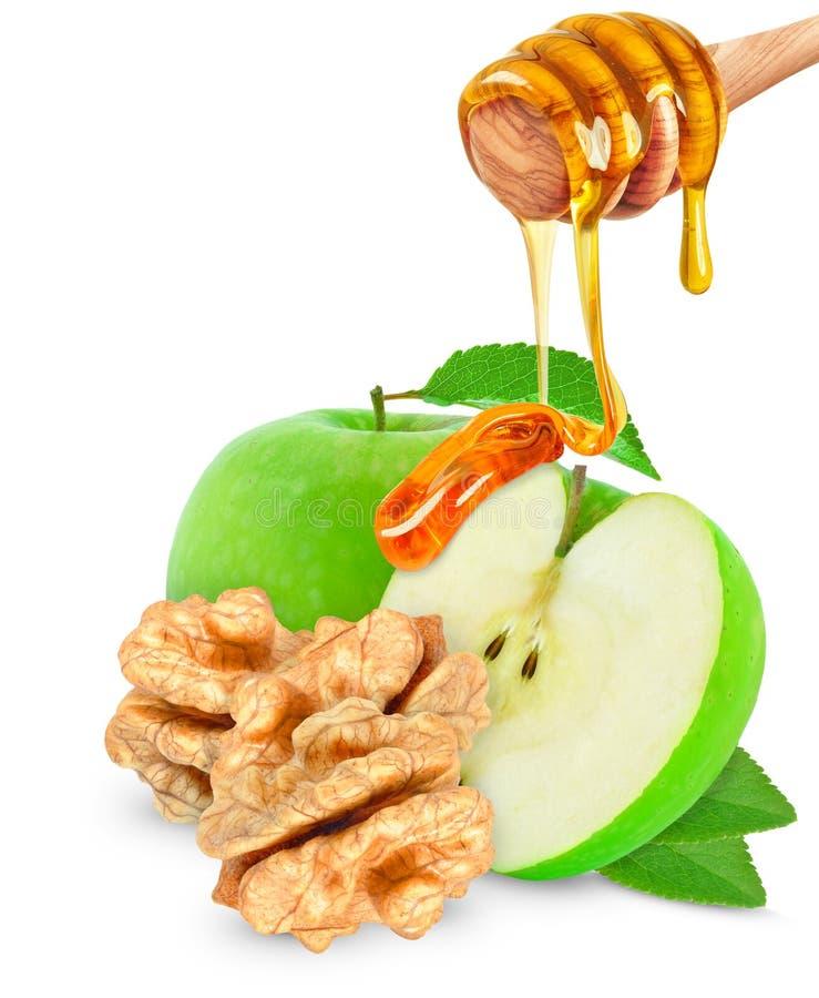 Apple με το μέλι και τα ξύλα καρυδιάς στοκ φωτογραφίες