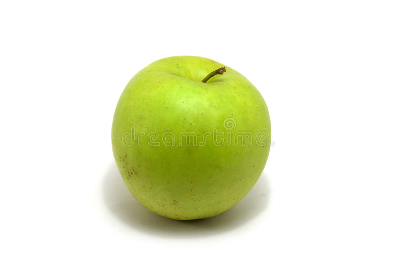 Apple. Isolated green apple in a white royalty free stock photos