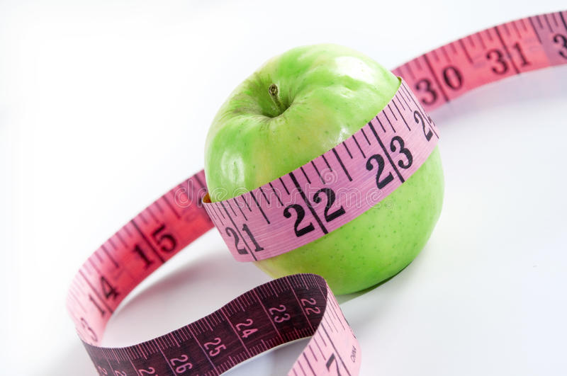 Apple. Measuring tape on white background royalty free stock photography