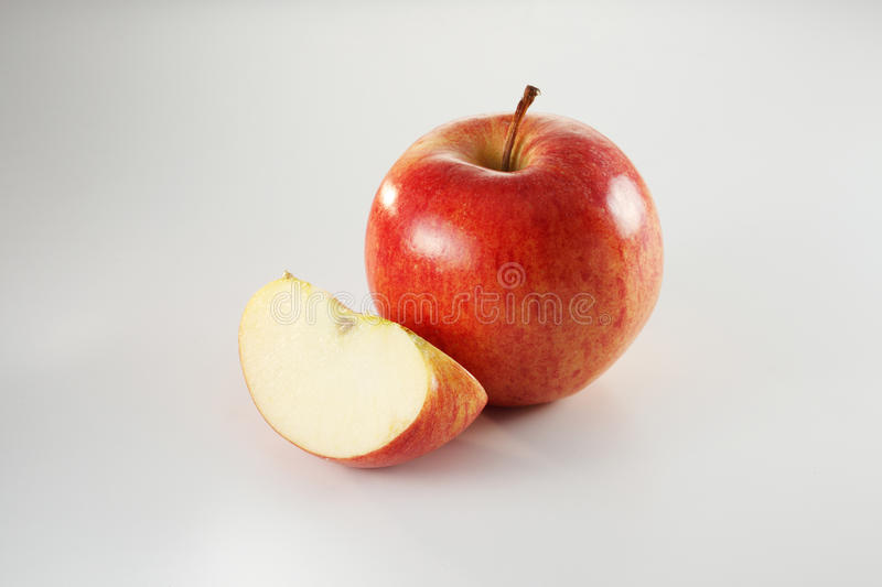 Apple. An image of an apple with a small slice at the side stock image