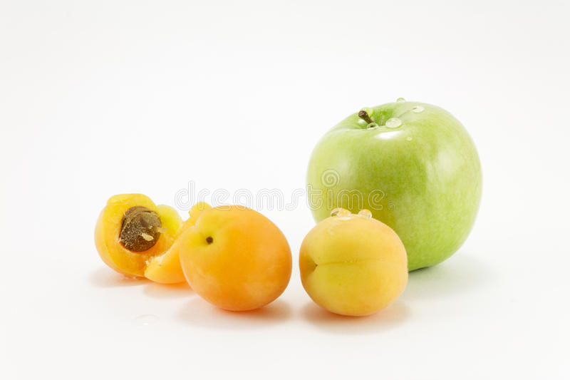 Apple and apricots stock photography