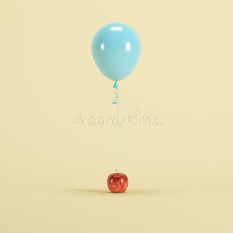 Apple attached with pastel blue balloon on light yellow background royalty free stock images