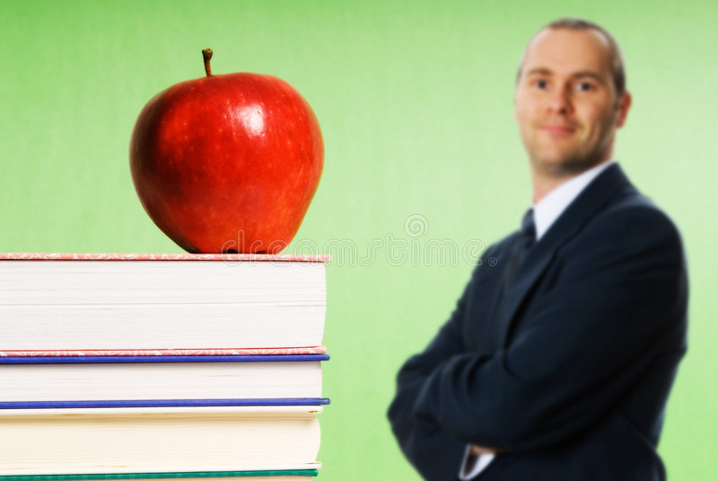 Apple auf Büchern stockfotos