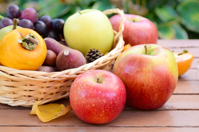 Apple and autumn fruits in a basket royalty free stock images