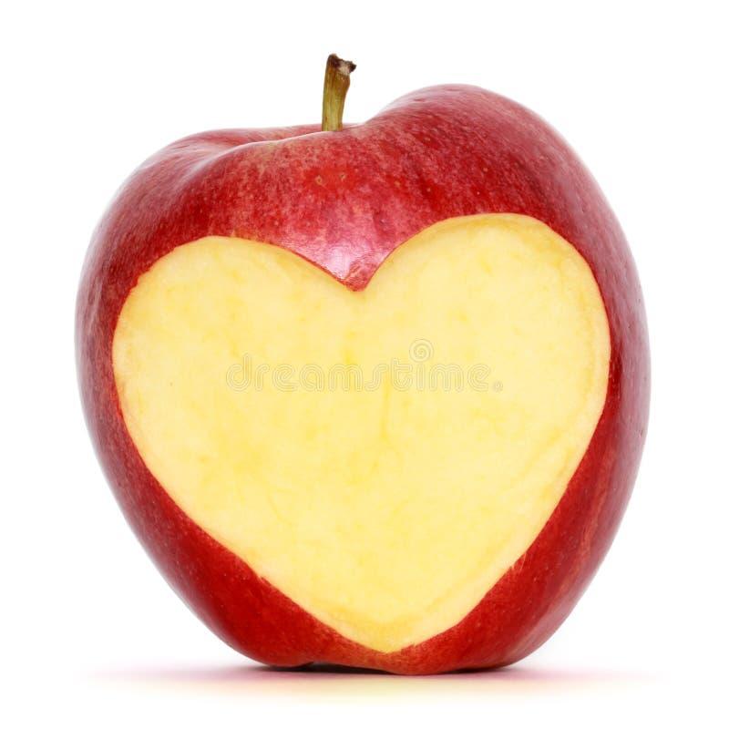 Apple avec le coeur photographie stock