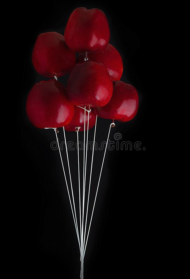 Apple balloon, apples red on black royalty free stock photo