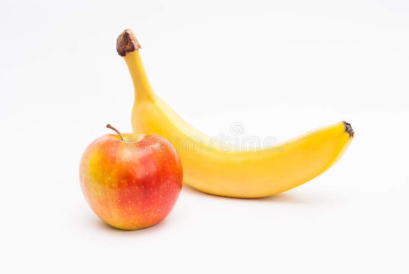 Apple and banana. Ripe apple and banana isolated on white background royalty free stock photos