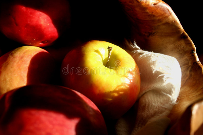 Apple In A Basket Royalty Free Stock Images