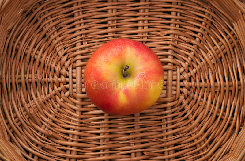 Apple in a basket royalty free stock photography