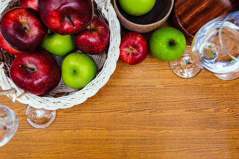 Apple are in basket and on the wood table. royalty free stock image