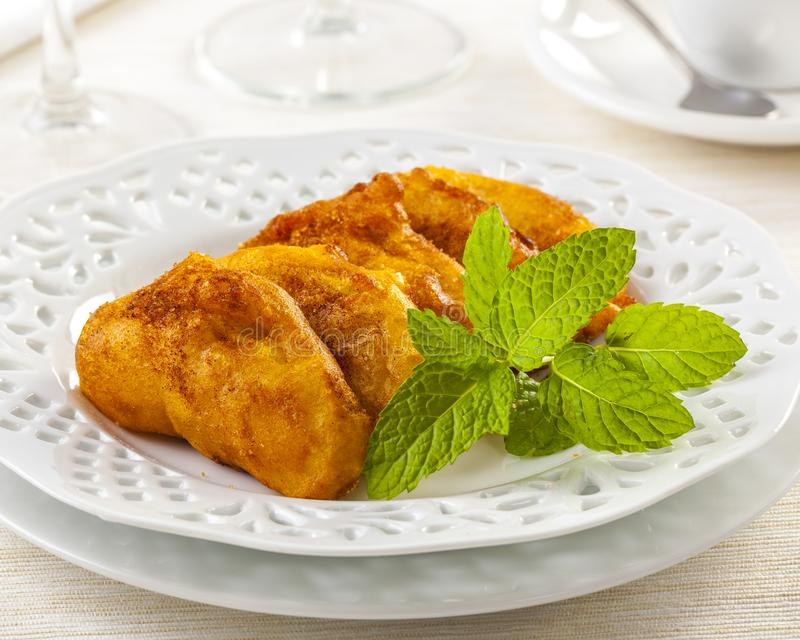 Apple beignets fried in oil stock photography
