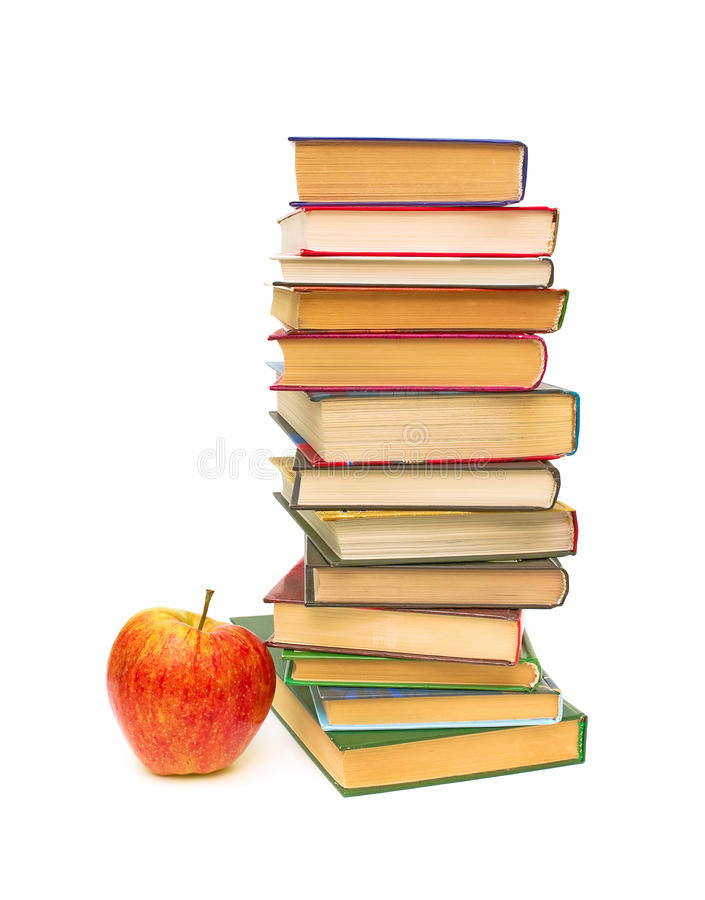 Apple and a big stack of books on white background stock photography